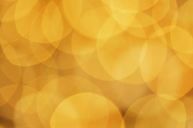 輝くクリスマス黄金ボケデザインの背景