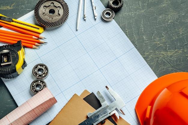 Автомобильные инженерные инструменты вид сверху на миллиметровой бумаге