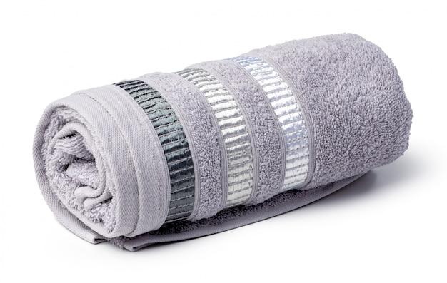 白い背景で隔離のタオルをクローズアップ