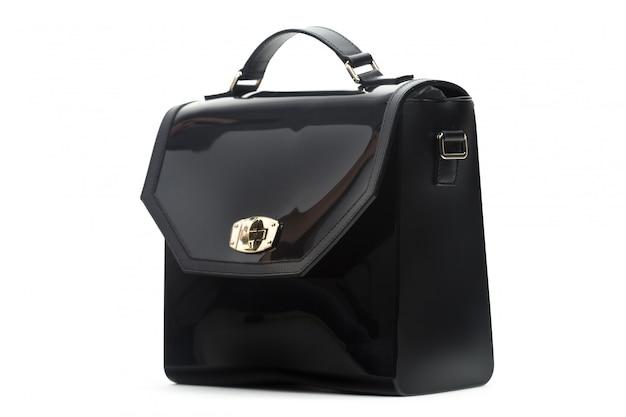 白い背景に分離された黒革の女性のハンドバッグ