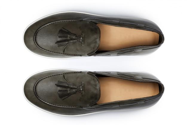 Ботинки изолированные на белой предпосылке.