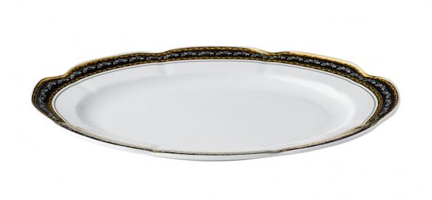 白い背景に分離された黄金の境界線を持つ白いセラミックテーブルプレート