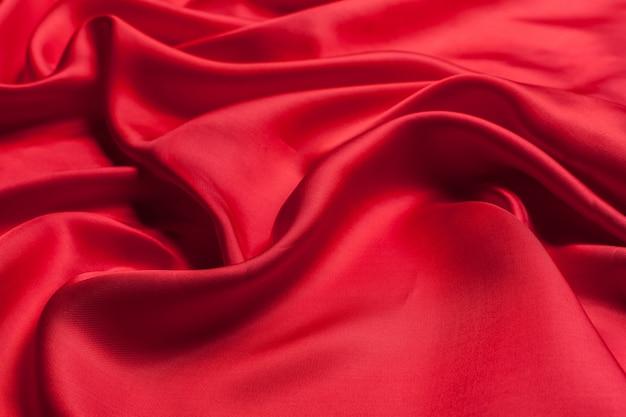 Красная ткань волны фоновой текстуры