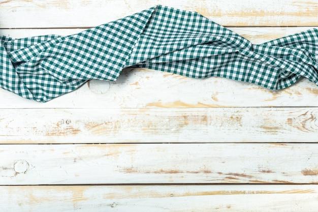 木製の背景にテーブルクロス繊維