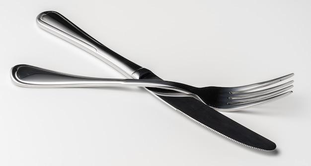 フォークとナイフは、白い背景で隔離