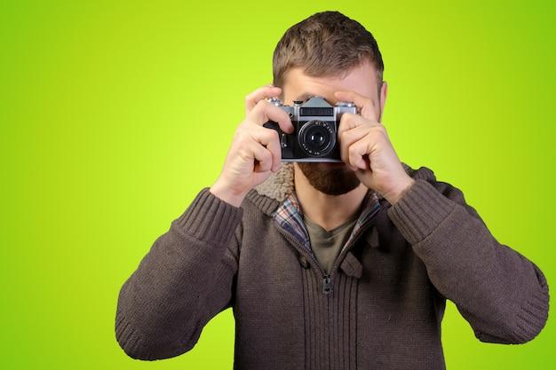 写真を撮る写真家