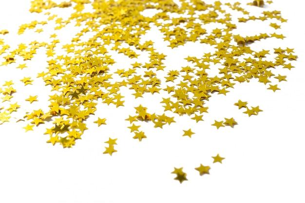 白い背景の上の星のパーティーの装飾