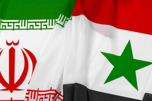 Флаги сирии и ирана вместе закрываются
