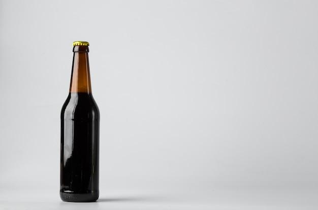 Бутылка пива на белом