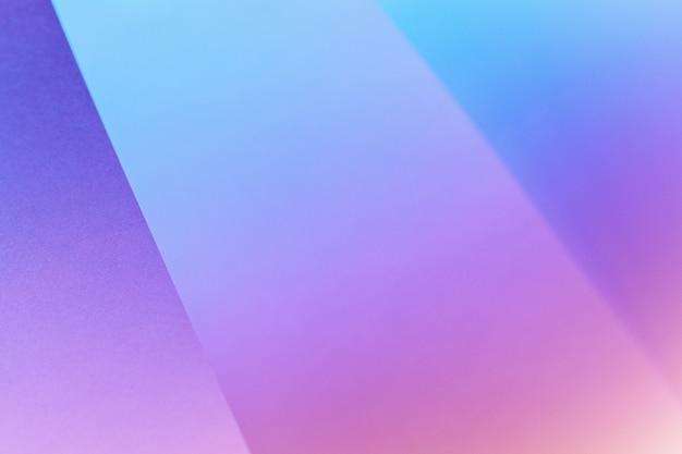 ネオンの光、コピー領域にカラフルな幾何学的な紙の背景