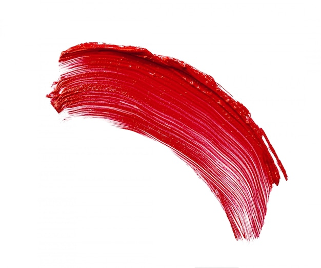 白で隔離される赤い口紅の汚れの汚れ
