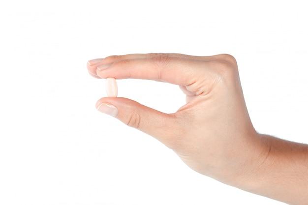 女性の手の丸薬