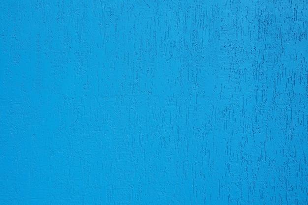 背景と亀裂と明るい青い壁のテクスチャ。