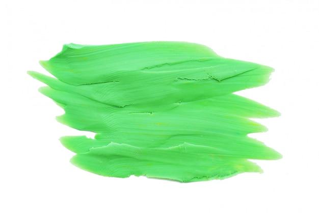 塗られた緑の粘土の背景とテクスチャの汚れ。白い背景に分離します。