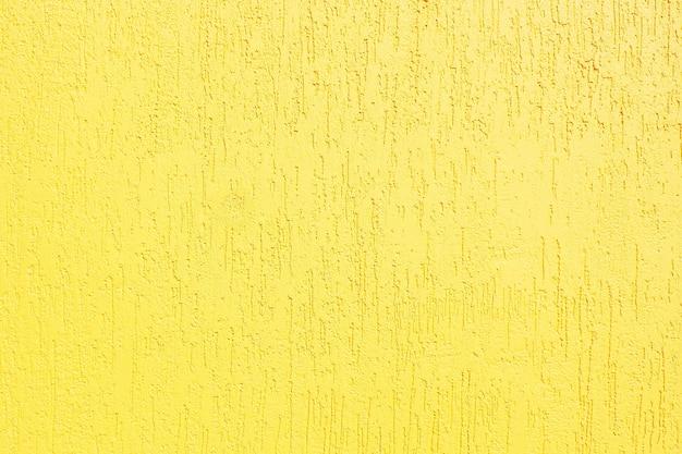 背景と黄色のテクスチャスタッコの壁のテクスチャ。