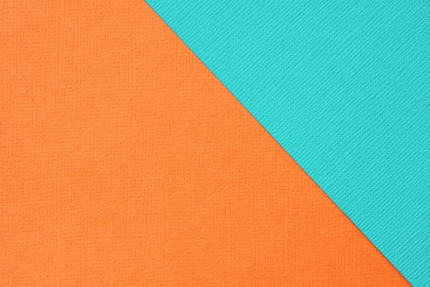 抽象的な幾何学的な背景の青緑色とオレンジ色のテクスチャ紙。