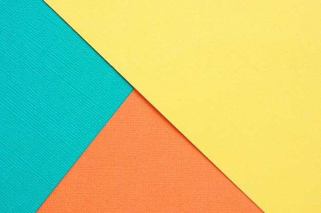 抽象的な幾何学的な背景の青緑色、黄色とオレンジ色のテクスチャ紙。