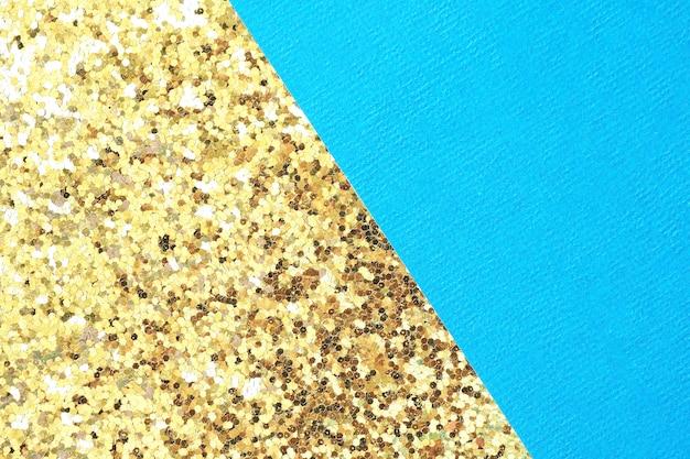 大きなキラキラと抽象的な幾何学的な背景の青いテクスチャと黄金の紙。