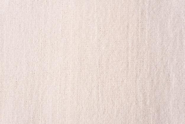背景テクスチャライトベージュ色を編みます。布繊維の背景