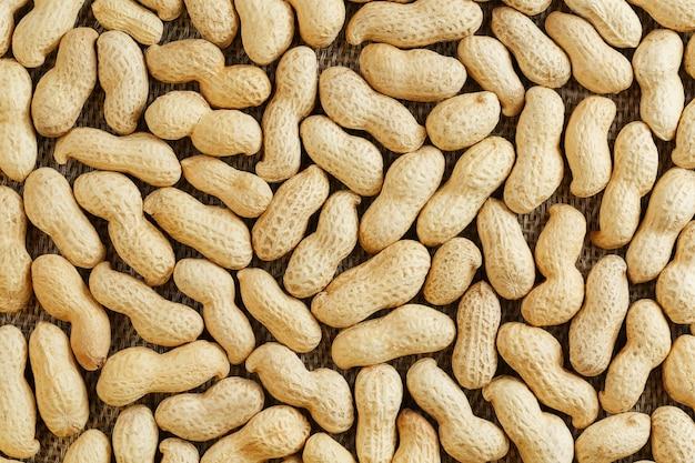 その殻のピーナッツテクスチャ食品の背景。