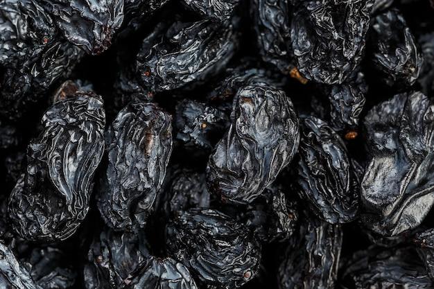 ブラックレーズンの質感、人気のドライフルーツ。乾燥ブドウ。