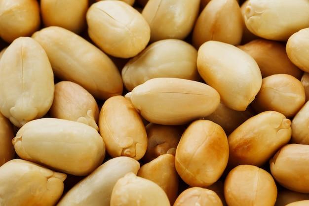 ピーナッツのテクスチャ。ピーナッツ豆の食べ物。
