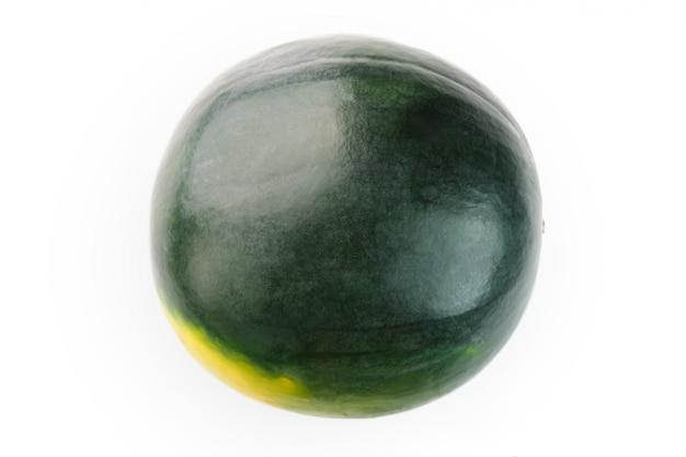 暗い緑の皮と白の黄色の斑点のあるスイカ