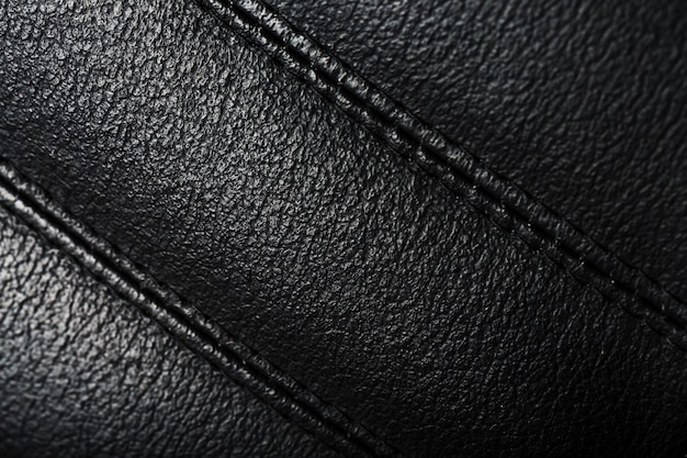 Текстура черных кожаных кресел швы закрываются.