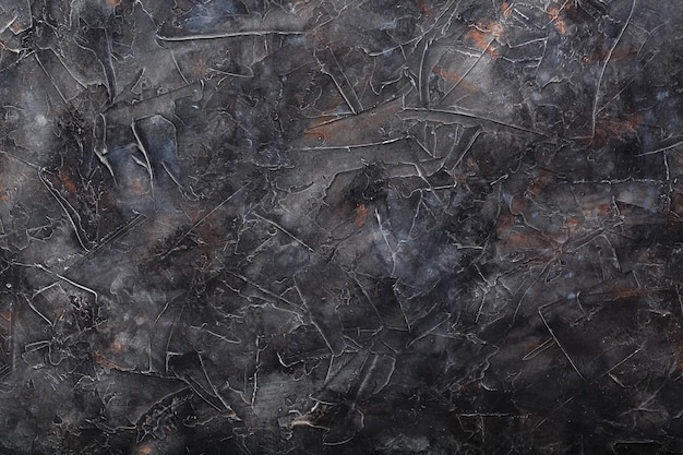 Темно-серая текстурированная каменная стена. полный экран как