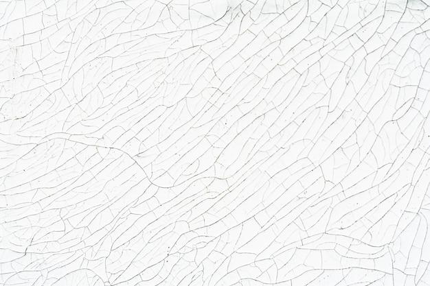 ひびの入った古い白いペンキの質感