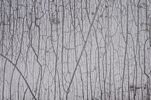 背景テクスチャ古い白いひびの入った壁のペンキとタイル