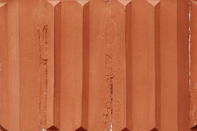 茶色の下見張りの背景テクスチャ壁およびフェンスのベニヤの高齢金属材料