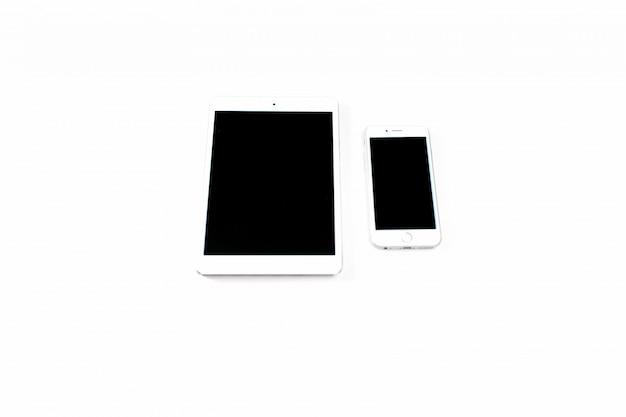 白いタブレットとスマートフォン。画面にグレアがあるスマートフォン