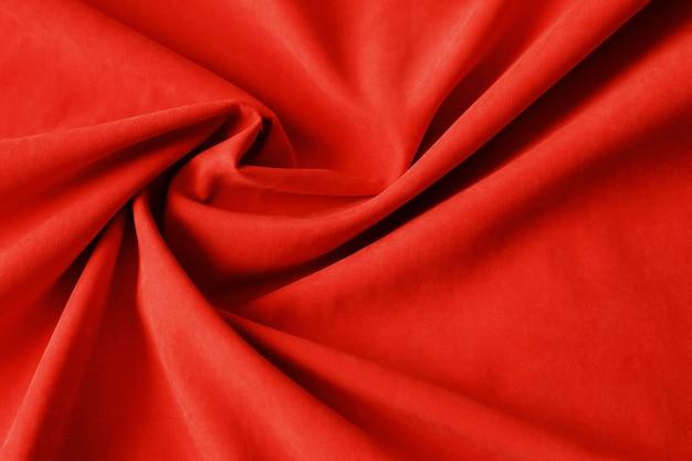 赤い布のテクスチャ背景、しわくちゃの布