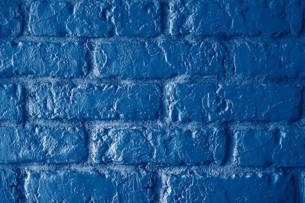 トレンディな古典的なダークブルーのレンガ壁ビンテージトーン背景