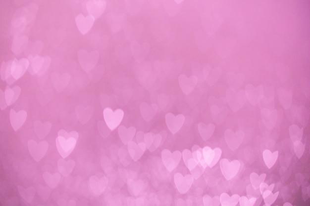 Расфокусированные огни боке фон розового сердца
