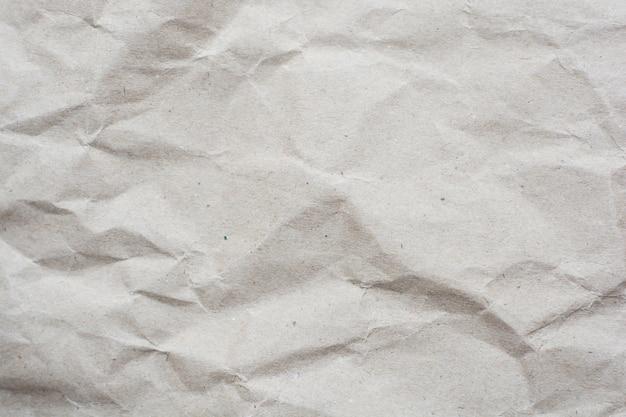 しわくちゃのクリーム色のトーン紙パターンテクスチャ背景