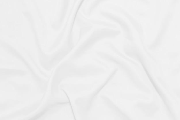 白いしわくちゃの毛布テクスチャ背景。