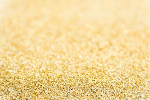 Расфокусированным фон золотой блеск. золотой абстрактный фон боке. рождественский абстрактный фон