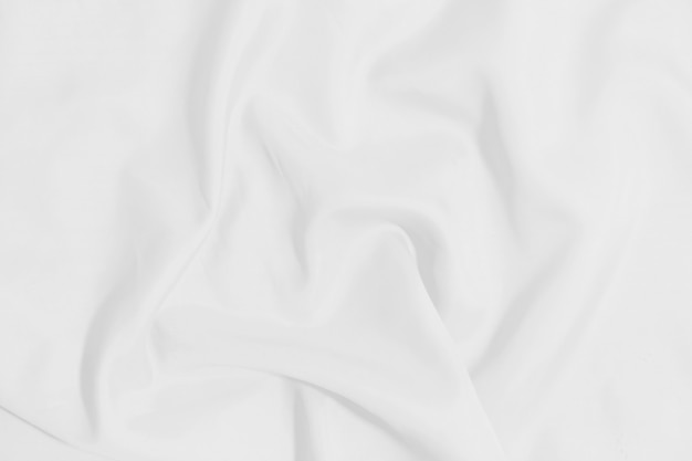 Белый мятый одеяло текстуры фона. белая ткань фон