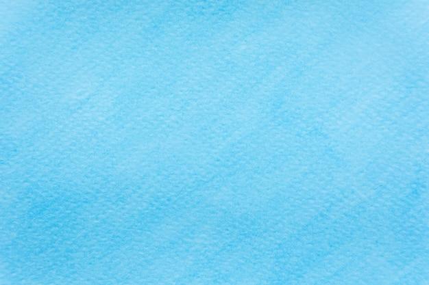 抽象的なスカイブルーの水彩の背景。バックグラウンド用の手塗りの水彩