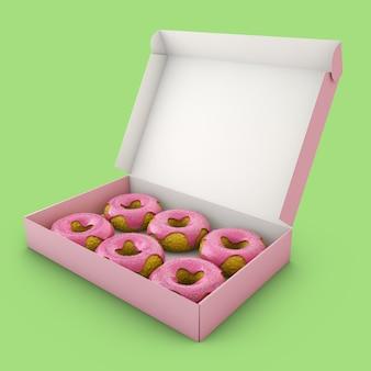 ボックスにピンクのアイシングでドーナツ。