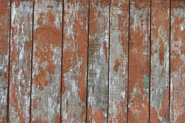 オレンジ色に塗られた古い木の板からの背景