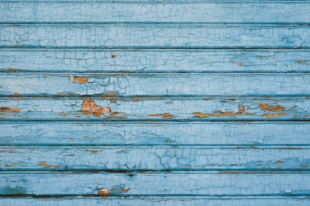 青い色で塗られた古い木の板からの背景