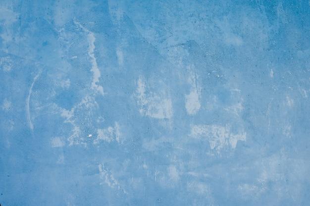 テクスチャと青い鉄の背景。漏れた塗料