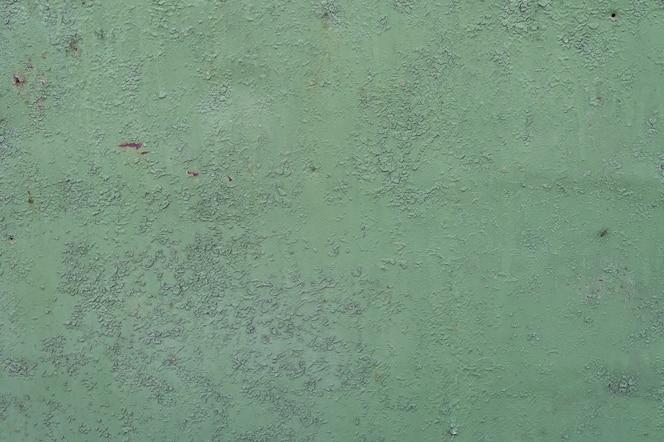 緑の金属の背景。ペンキを注いだ。金属のテクスチャを背景として使用できます