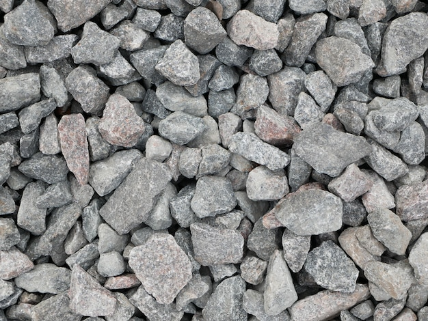 灰色の小石。閉じる。石積み、材料、表面、フラット、フロント、ビュー、パターン、抽象、背景、デザイン。灰色の小石。