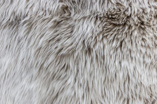 毛むくじゃらの毛皮のカーペットのテクスチャの背景のパターン