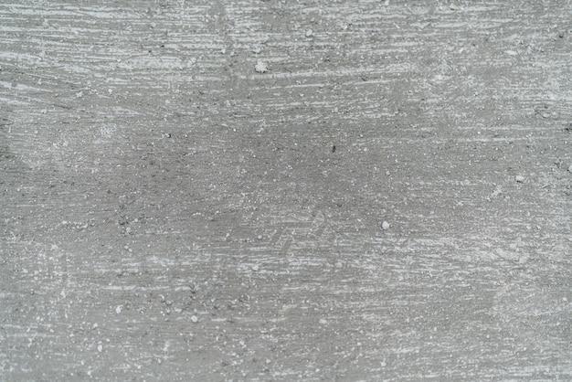 ブラシの洗面の詳細と素朴なコンクリートのテクスチャ