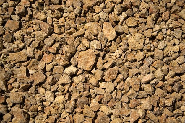 Текстура конструкции камня утеса щебня на земле.